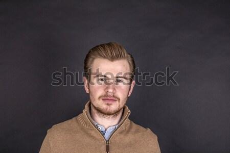 Cool jongen Blauw shirt poseren studio Stockfoto © meinzahn