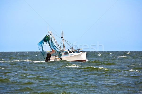 small fishing boat heading out to the ocean Stock photo © meinzahn