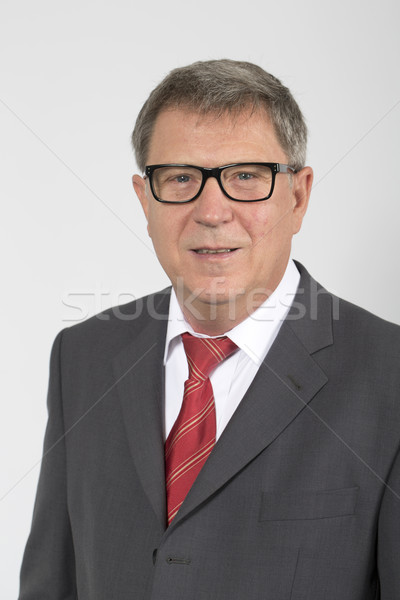 Portrait of smiling business man, isolated over white background Stock photo © meinzahn