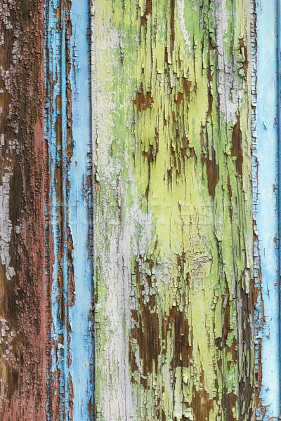 colorful wet wooden facade with peeling color Stock photo © meinzahn