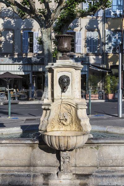 old water fountain with greek roman face at faucet Stock photo © meinzahn