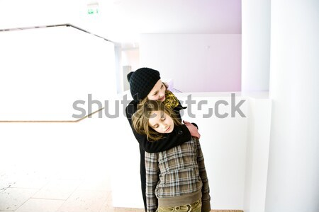 sisters hugging and take care in a white room Stock photo © meinzahn