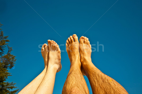 leg and feet of man and child with blue sky Stock photo © meinzahn