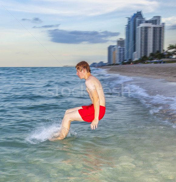 boy jumps with speed into the ocean Stock photo © meinzahn