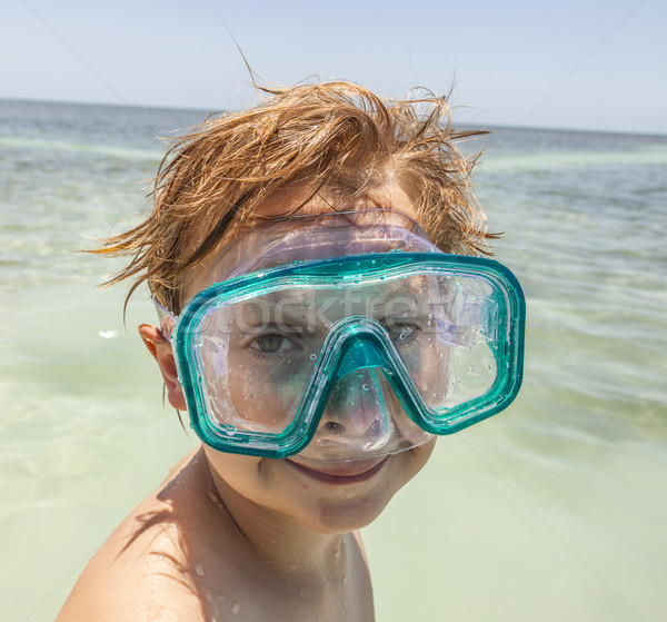 boy with diving mask enjoys the ocean Stock photo © meinzahn