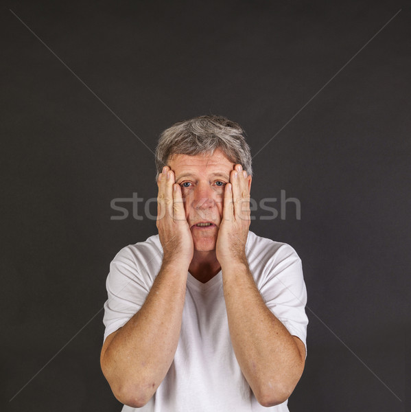 casual dressed angry man in studio in sorrow Stock photo © meinzahn