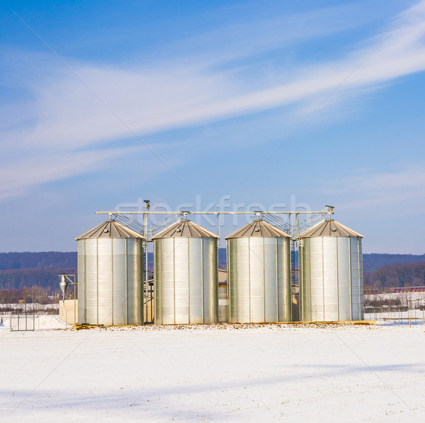 landscape with silo and snow white acre with blue sky Stock photo © meinzahn