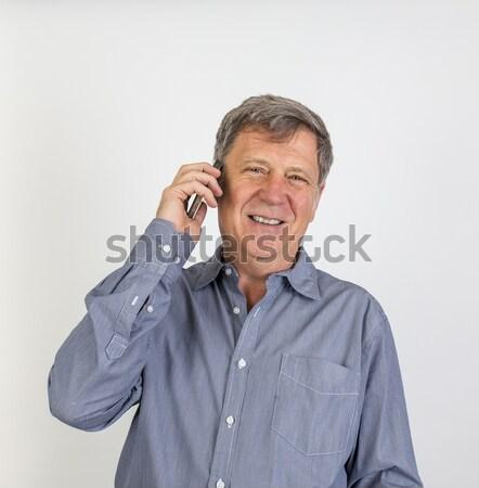 Portret gelukkig man mobiele telefoon hand telefoon Stockfoto © meinzahn