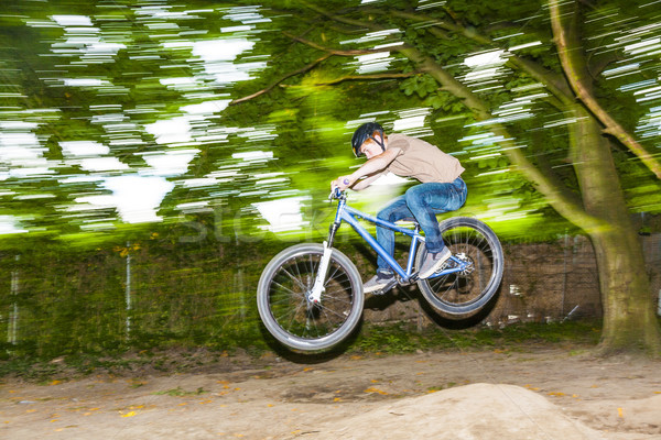 child has fun jumping with thé bike over a ramp  Stock photo © meinzahn