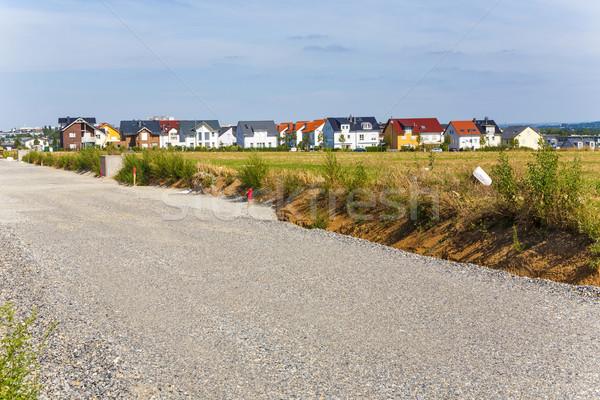 Nuevos viviendas hermosa paisaje carretera construcción Foto stock © meinzahn