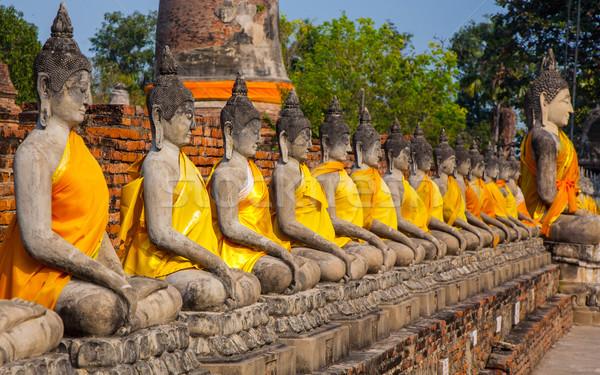 Buddha statues at the temple of Wat Yai Chai Mongkol  Stock photo © meinzahn