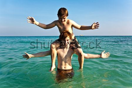 brothers are playing together in a beautiful sea with crystal cl Stock photo © meinzahn