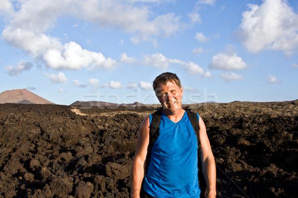 man walking in lava field  Stock photo © meinzahn