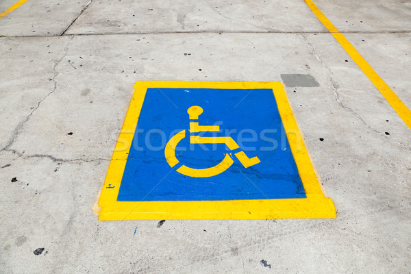 Handicapped symbol on parking space  Stock photo © meinzahn