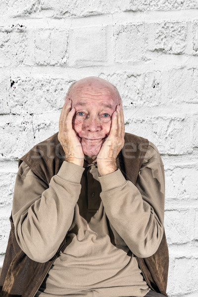 elderly man in sorrow holding head in hands Stock photo © meinzahn