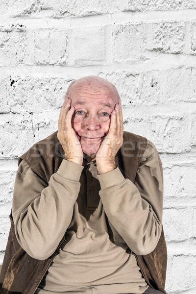 Starszych człowiek żal głowie ręce Zdjęcia stock © meinzahn