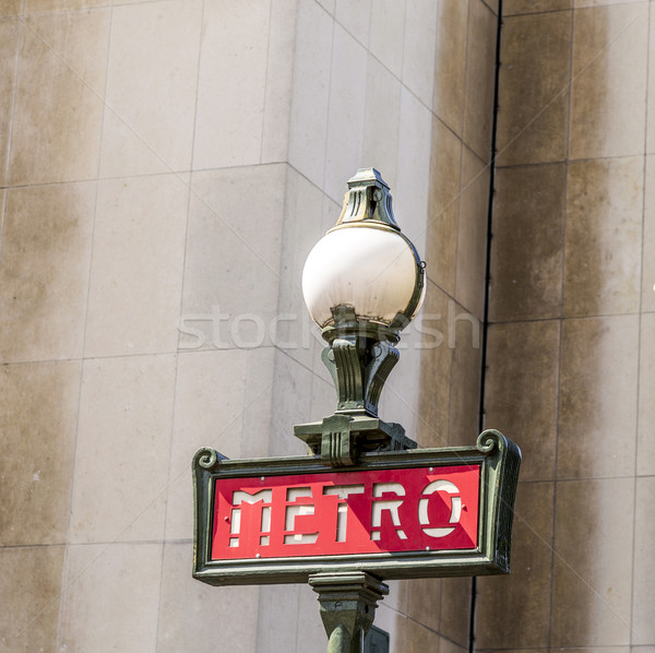 Parisian metro sign with a lamppost against  vintage wall Stock photo © meinzahn