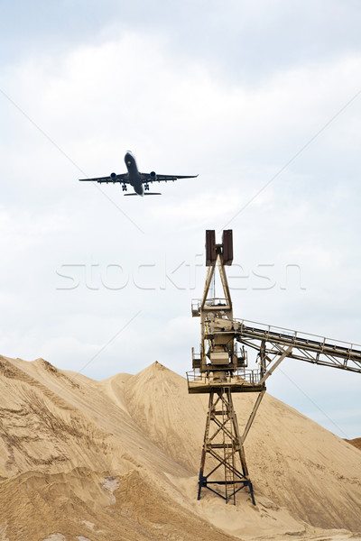 Aircraft in landing approach over gravel pit Stock photo © meinzahn