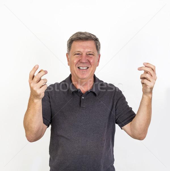 Lachend glimlachend senior man gelukkig handen Stockfoto © meinzahn
