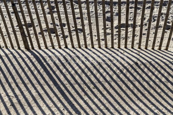 çit plaj harmonik gölge sabah ışık Stok fotoğraf © meinzahn