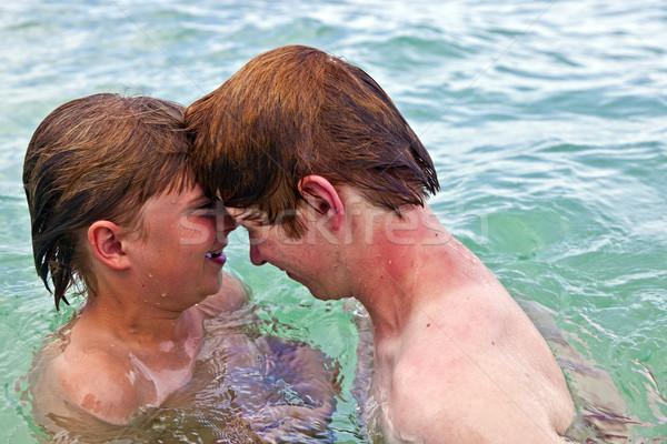 boys having fun in the clear sea  Stock photo © meinzahn