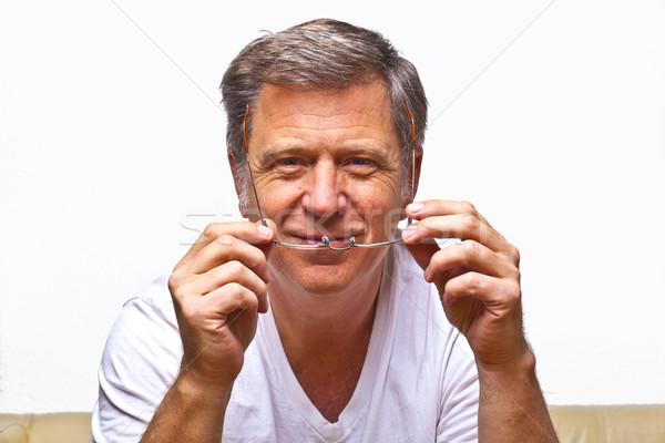 Man leesbril glimlachend glimlach gezicht ogen Stockfoto © meinzahn