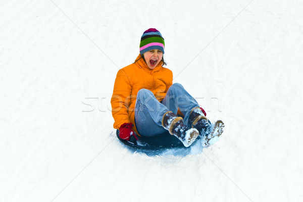 beautiful girl sledging down the hill on snow Stock photo © meinzahn