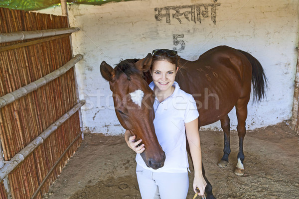 woman with her horse hugging in the stable Stock photo © meinzahn