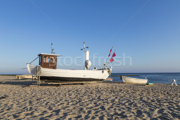 A fishing boat on shore of the Baltic Sea in Koserow, Germany. Stock photo © meinzahn