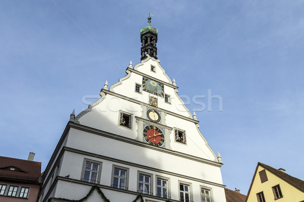 Peak Of A Building With A Clock Against A Blue Sky in Rothenburg Stock photo © meinzahn