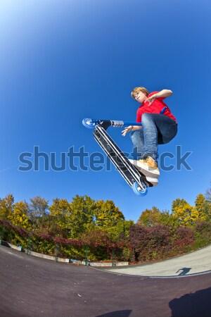 Fiú moped felhők boldog sport haj Stock fotó © meinzahn