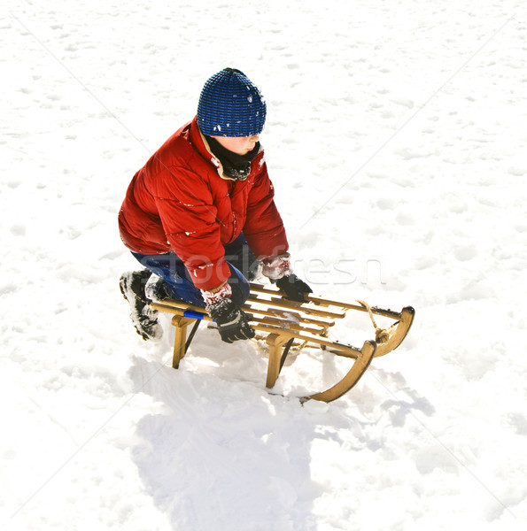 young boy sledding down the hill in snow, white winter Stock photo © meinzahn