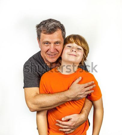 father and son hugging in studio isolated on white Stock photo © meinzahn