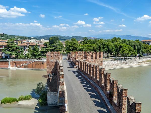 people at old bridge in Verona over Adige river - Castelvecchio Stock photo © meinzahn
