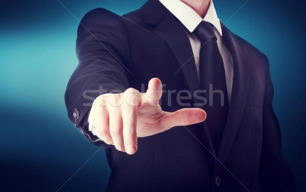 деловой человек указывая что-то прикасаться синий Сток-фото © Melpomene