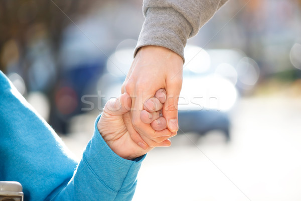 Caregiver Holding Senior's Hand  Stock photo © Melpomene