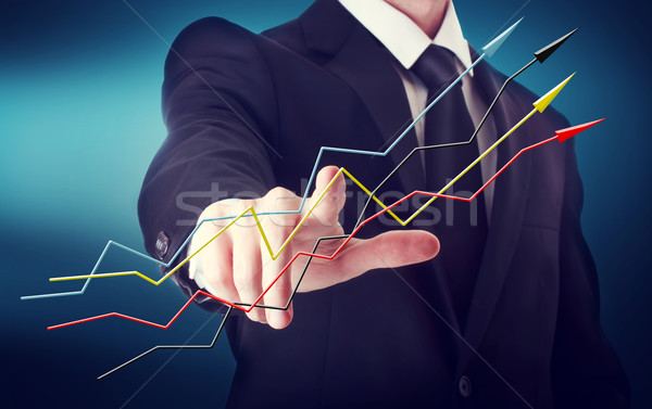 Stock photo: Businessman with Rising Arrows