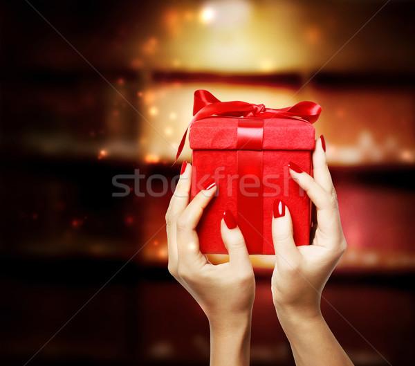 Stock photo: Woman Displaying Red Gift Box