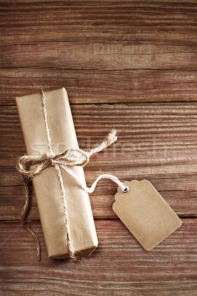 Gift box on rustic wooden table Stock photo © Melpomene