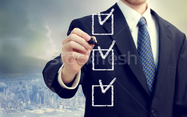 Business man with checkboxes Stock photo © Melpomene