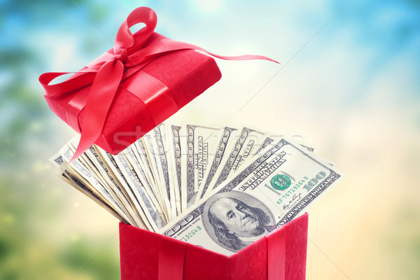 Stock photo: Hundred dollar bills in a big red present box