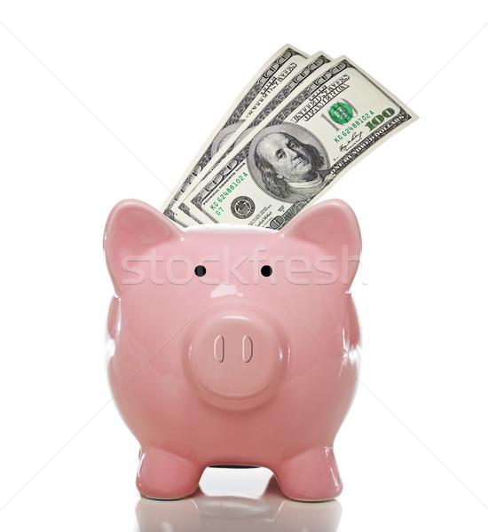 Różowy banku piggy sto jeden biały Zdjęcia stock © Melpomene
