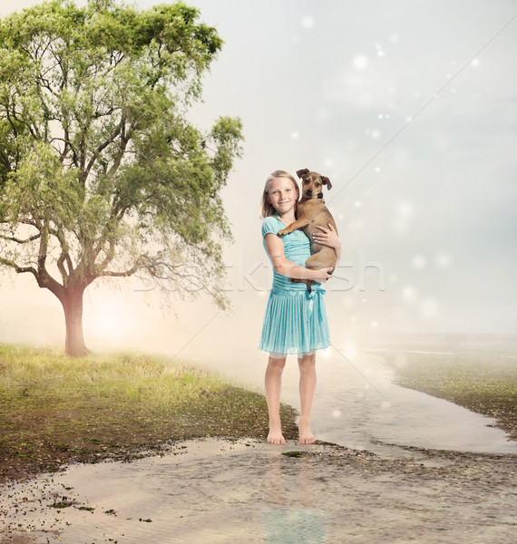 Girl Holding her Puppy at a Magical Brook Stock photo © Melpomene