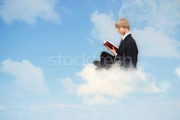 Reading book on the cloud Stock photo © Melpomene