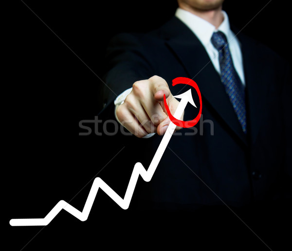 Businessman with graph Stock photo © Melpomene