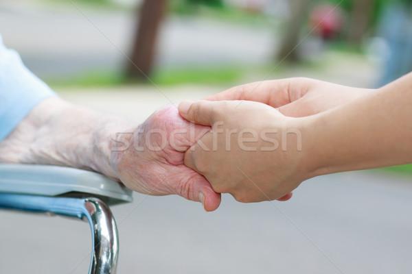 Gondozó tart idős kéz kívül család Stock fotó © Melpomene