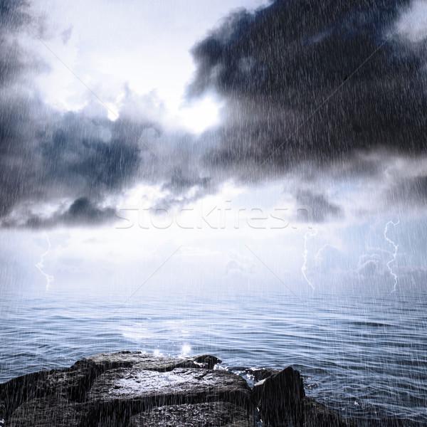 Yağmur sağanak okyanus güneş ışığı gökyüzü bulutlar Stok fotoğraf © Melpomene