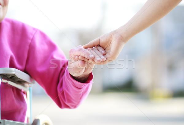 Starszy pani wózek trzymając się za ręce strony miłości Zdjęcia stock © Melpomene
