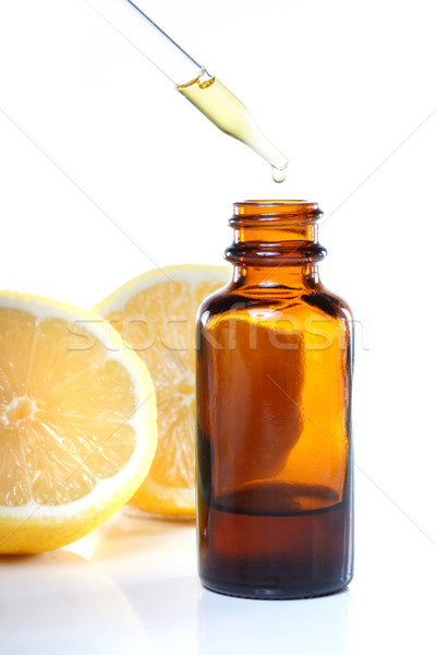 Herbal medicine dropper bottle with lemons Stock photo © Melpomene