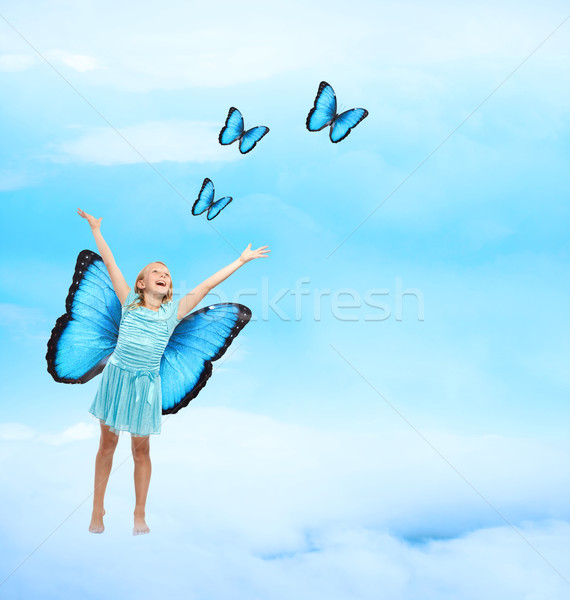 Gelukkig jong meisje vlinders Blauw jurk armen Stockfoto © Melpomene